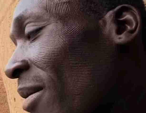 Man Facial Scarification