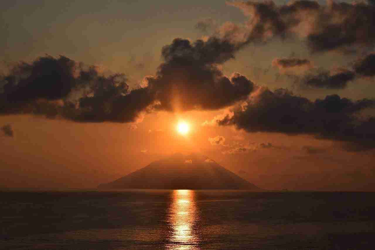 sun cloud sea volcano