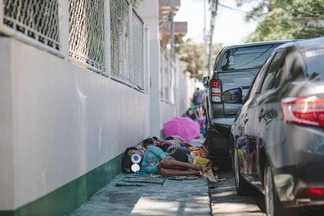 people lying on pavement vehicles