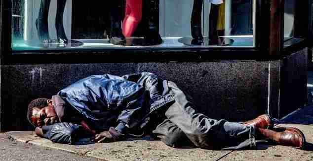photo of homeless man sleeping